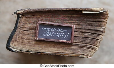 lettering congratulations graduates and old book - greeting, invitation card, vintage style