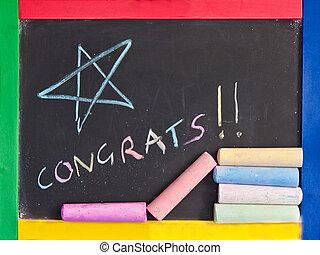 Congratulations written on a blackbaord