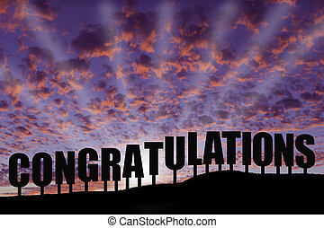 """The word """"congratulations"""" spelled out and silhouetted on a hillside with a fabulous sunrise/sunset and colorful clouds."""