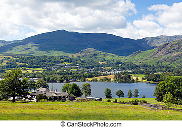 Coniston Water Lake District England uk with mountains and blue sky and white clouds on a beautiful summer day