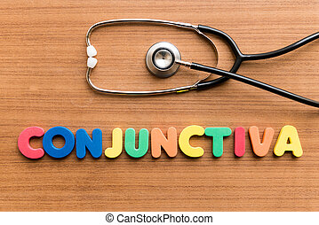Conjunctiva colorful word with Stethoscope on wooden...