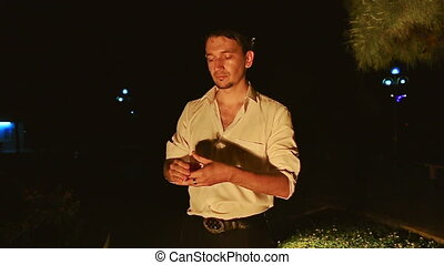Conjurer Does Juggling with Cards High in Air in Dark Park -...