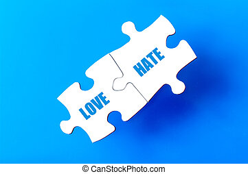 Connected puzzle pieces with words LOVE and HATE