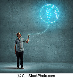 Connected with world - Young man with Eath planet balloon in...