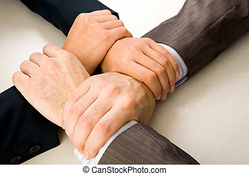 Connection - Image of crossed hands of business partners