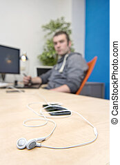 connectivity - Ear phones, lying on a clean, paperless desk,...
