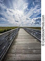 Connor Creek Bridge under blue sky.