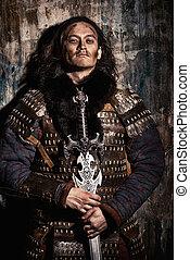 conqueror man - Ancient male warrior in armor holding sword....