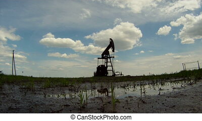 Consequences of oil production - Oil rig extracts resources...