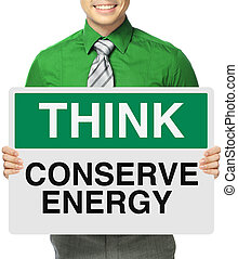 Conserve Energy - A man holding a signboard on energy...