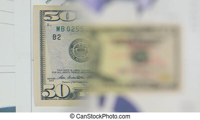 Consider a banknote of fifty dollars, an increase with a...
