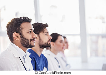 Considerate physicians hearing lecture at conference