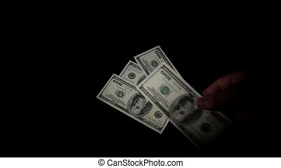 considers money isolated on black background