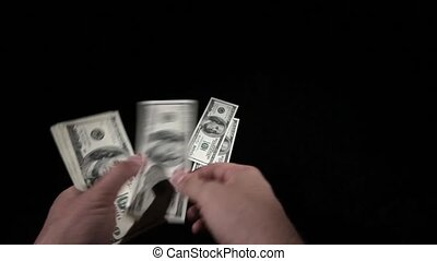 considers money isolated on black background