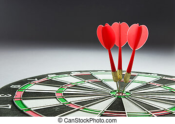Consistency - Three red darts pinned right on the center of ...