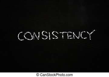 consistency word written with chalk on blackboard