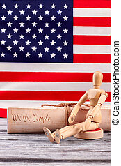 Constitution of US and wooden human dummy.