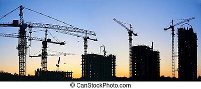 construção, guindastes, silueta, pôr do sol
