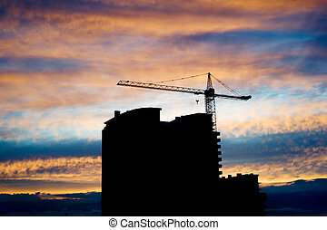 Construcion site in front of beautiful sunset sky
