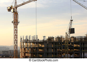Construction activity. Silhouette of construction worker