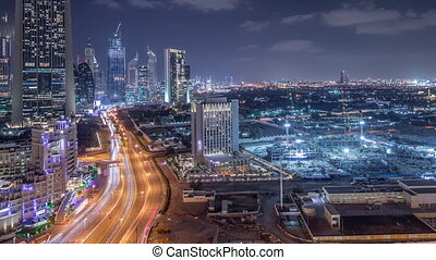 Construction activity in Dubai downtown with cranes and...