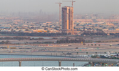 Construction and intersection near Dubai Creek Harbor aerial timelapse. Dubai - UAE.