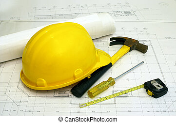 Architectural Floor Plans and Some Builders' Tools - a hammer, screwdriver & measuring tape