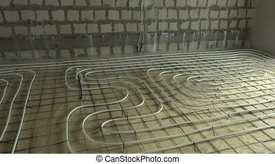 Construction area with heating pipes on floor. Rooms without...