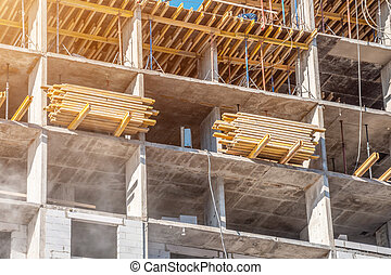 Construction, boards on the floor of a multistory building.