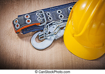Construction body belt with metal carabiners chain hard hat on w