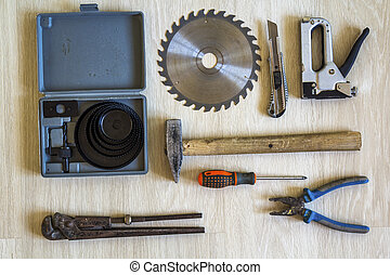 Construction, building and repair tools set for house work on wooden  background. Top view.