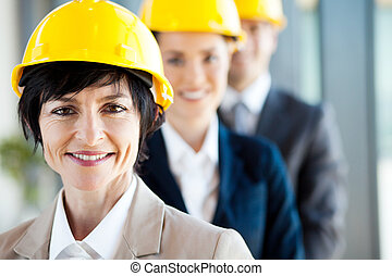 construction business leader and team - middle aged female...