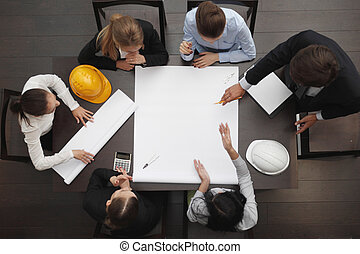 Construction business meeting - Top view of people around...