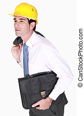 construction businessman holding a briefcase