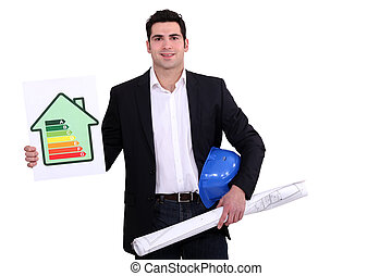 construction businessman holding an energy consumption label