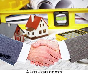Construction company agent handshake with a client.
