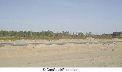 Construction, concreting of airport runways, roads. Men,...