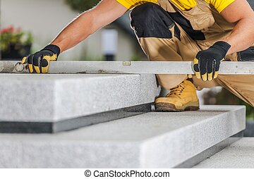 Checking Stairs Levels - Construction Contractor Checking...