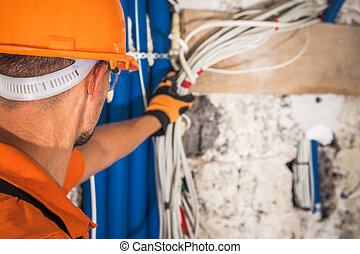 Construction Contractor Looking Inside Electrical Installation