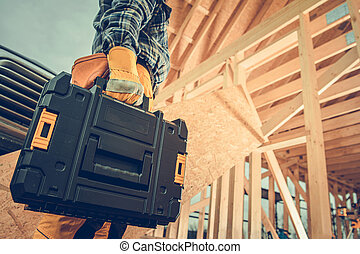 Construction Contractor with Plastic Power Tools Box in His Hand
