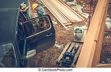 Construction Contractor Worker, Pickup Truck and the Job Site