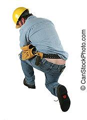 Construction Crack - A construction worker bending over,...