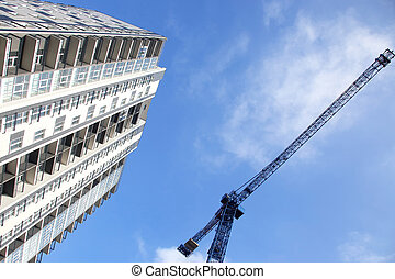 construction crane and newly built high-rise residential building