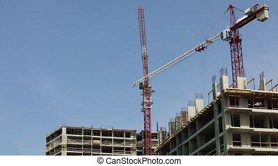 Construction Crane at Building Construction Site - Quick ...
