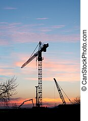 Construction crane at sunset.
