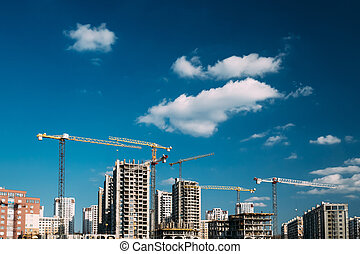 Construction Crane Is Involved In Development Of A New Multi-storey Residential Building