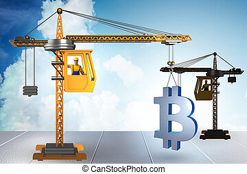 Construction crane lifting bitcoin in cryptocurrency concept