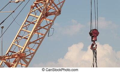 Construction crane lifting cargo