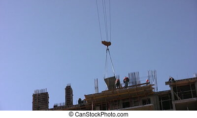 Construction crane moves cargo