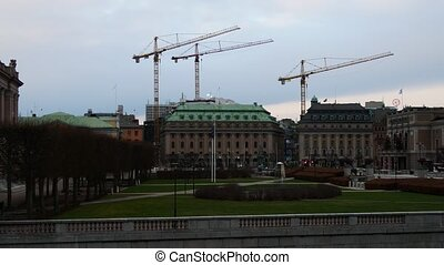 Construction crane near Riksdag Parliament Building In Stockholm, Sweden.